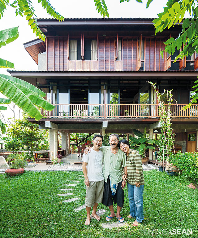 Family members are all smiles with the Thai-style ranch home in the  backdrop.