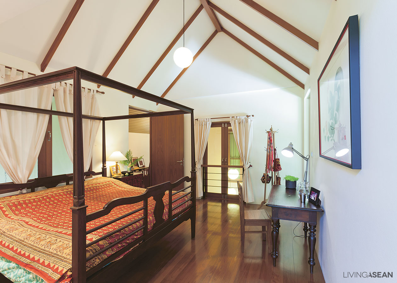 The master bedroom on the second floor boasts high ceilings in peaceful cream tones sloped ceilings and cool bed cover design add to the overall appeal of
