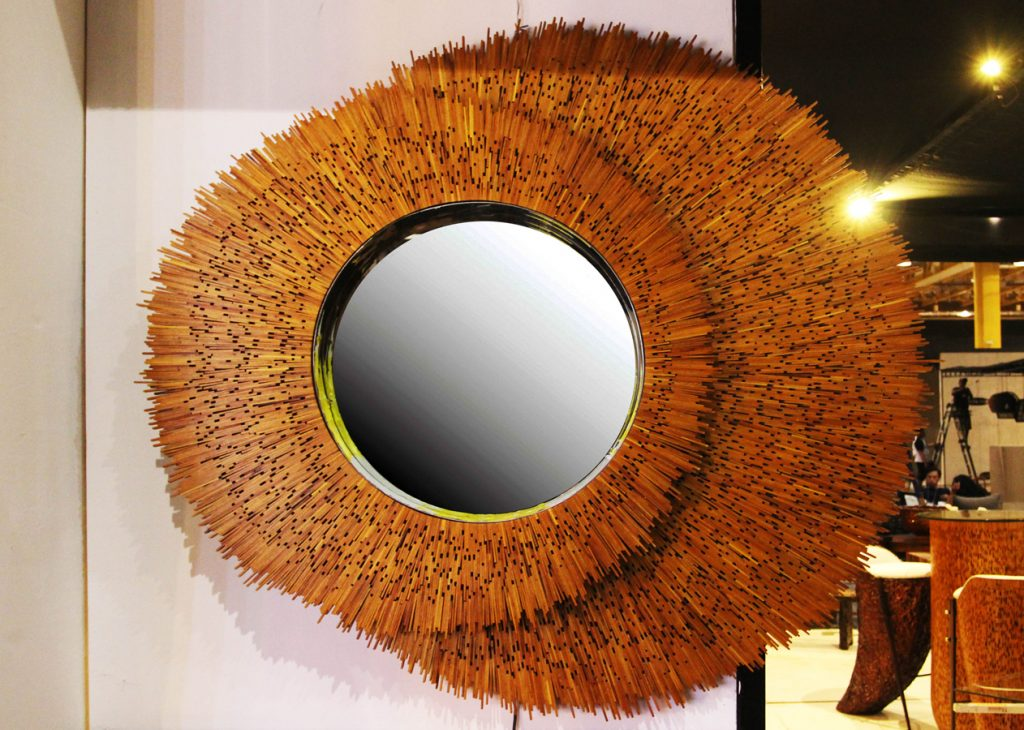 A strikingly beautiful mirror on wooden frame