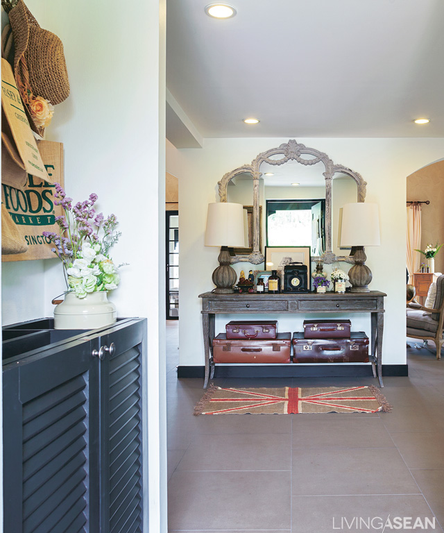 We come in from the carport to a welcoming parlor furnished with an antique console dresser.