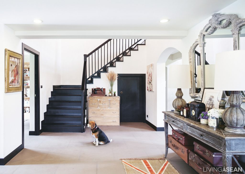 The stairway in the entry hall leads up to the second floor.
