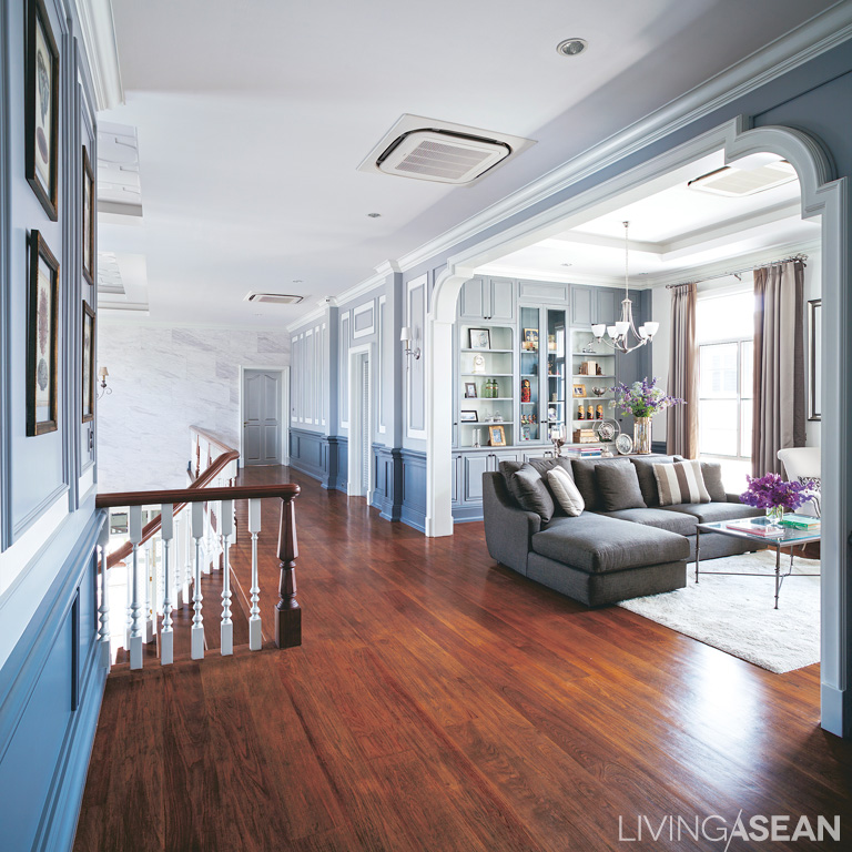 """Upstairs, they """"living room"""" corner right near the staircase in the center of the house, is a practical place to meet and chat before bedtime."""