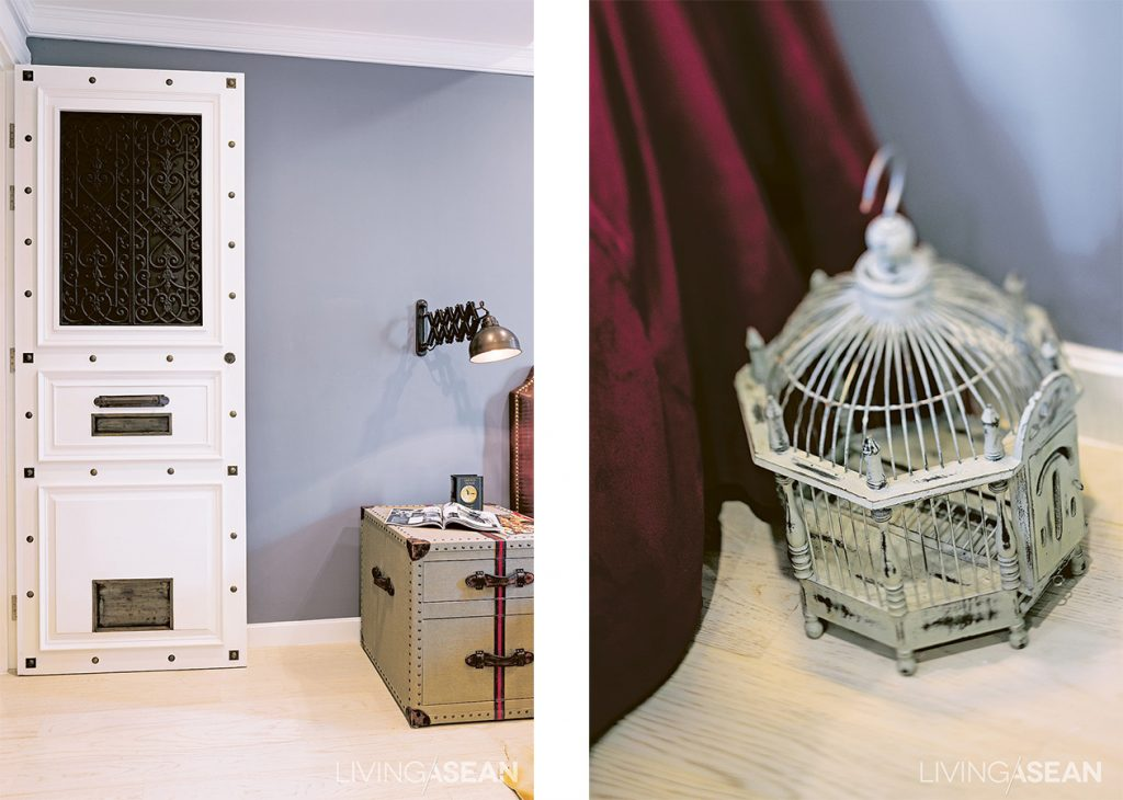 The designer has managed to adjust the room plan and move a door for added convenience. He also inserted a little pet door for Minnie, their dog. The door has a unique look, studded with different kinds of brass rivets.