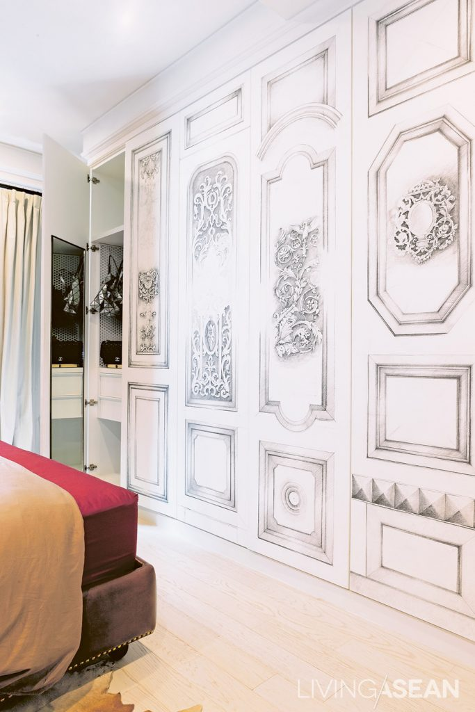 """The intricate patterns on the closet surface are the designer's solution to the original design. """"These started out as engravings, but it was taking so long. The designer turned them into illustration works instead. The closet ended up being really beautiful, and we love it."""""""