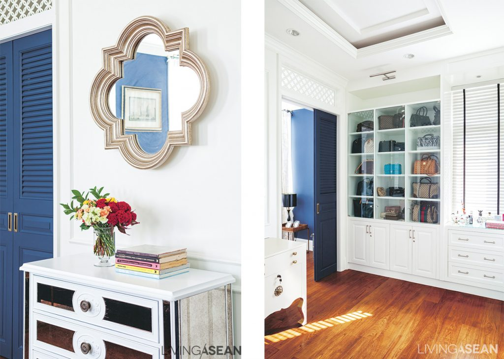 Simple but effective, a mirror with a fashionable, classically elegant shape hangs on the wall. /// The dressing room has a built-in cabinet with a clear glass surface for easy access to stored items.