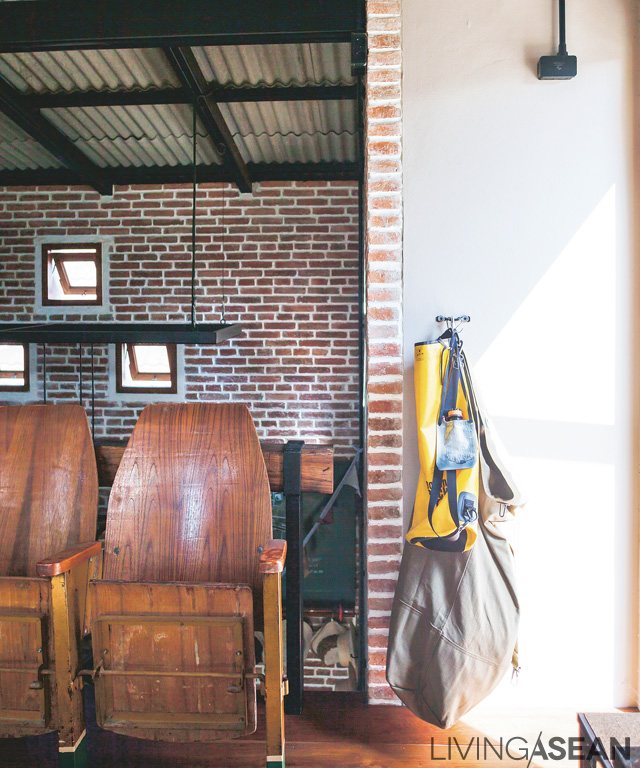 Old theater seats made of wood are placed here temporarily as the homeowners try to find a perfect spot for it.