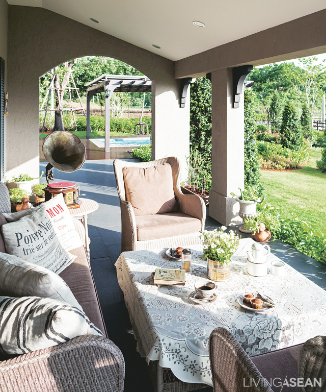 A verandah with warm-colored wicker sofa and chairs opens out directly from the living room. On good-weather days this is a great place for breakfast or an informal lunch.