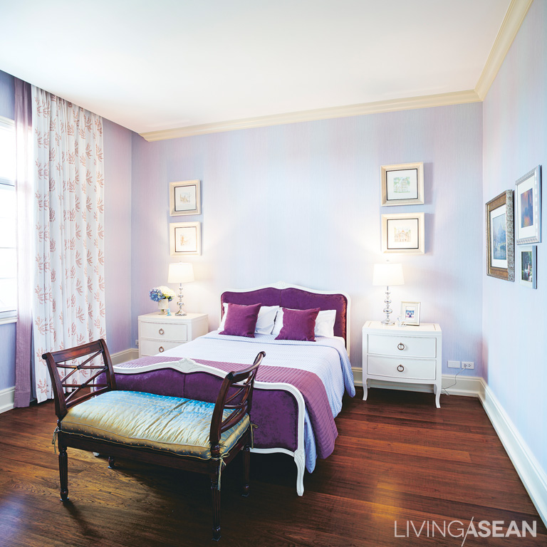 The small bedroom features a gorgeous combination of lavender, white, and cream made for a sweet atmosphere.