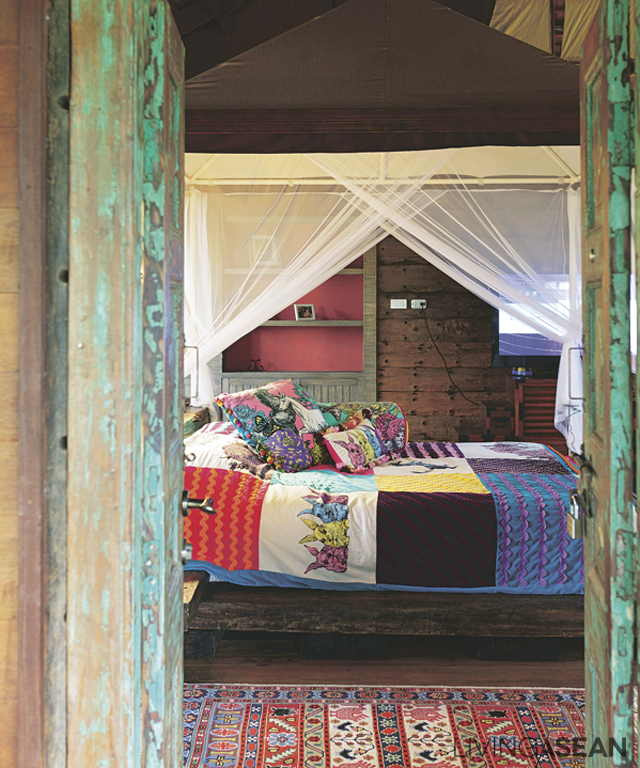 """The master bedroom is spacious with an old wooden bed in it. """"The bed is a case of serendipity. By chance I came across old railroad ties up for sale. They were very heavy and needed seven to eight people to transport them up here."""""""