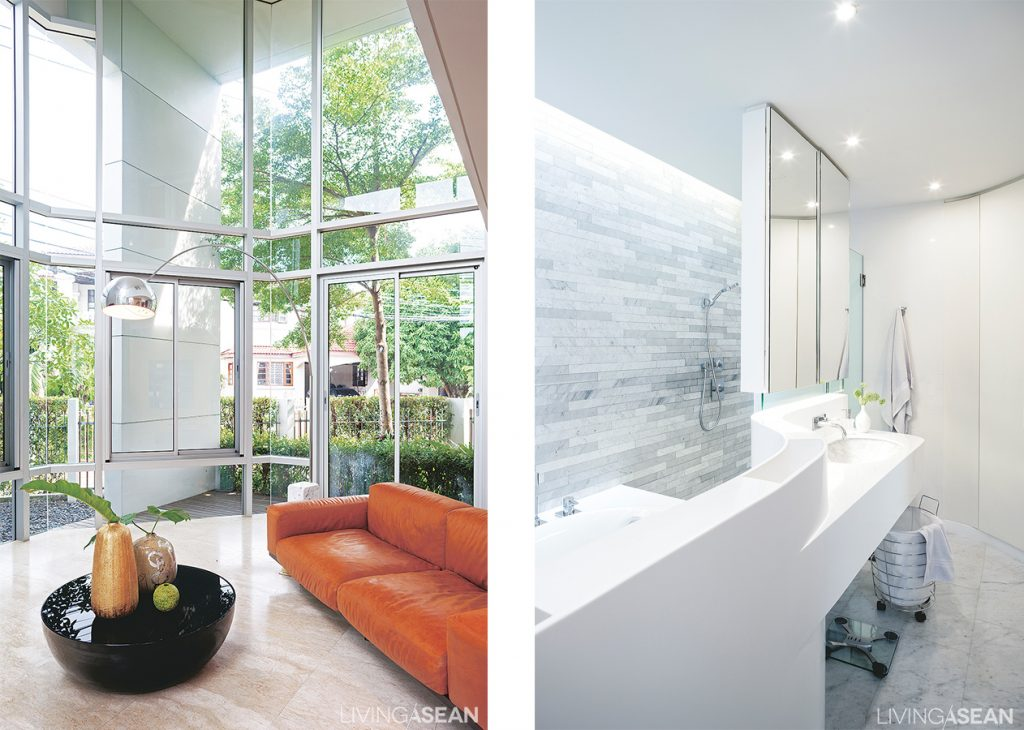 Reception parlor following the traditional Thai 'Sala' concept. A large glass wall opens wide to the natural world of plants and trees outside. /// The bathroom design has uniquely stylish lines.