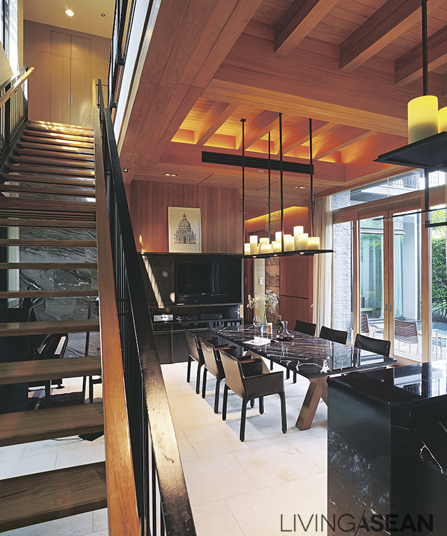 The dining room is decorated in a modern style with a mild classic flavor from stone furniture, candelabra-like ceiling lamps and a cross-shaped table legs.