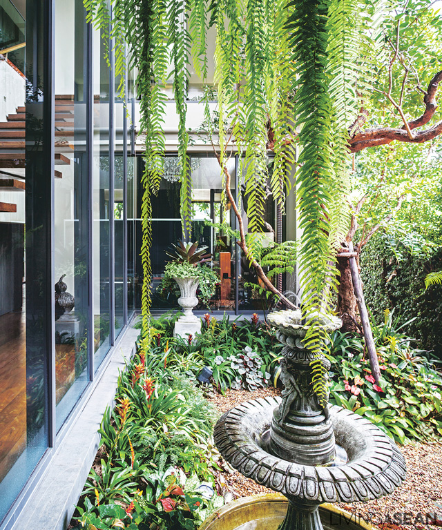Near the stairway to the second floor is a courtyard where a tiny English garden reigns supreme, visible from every corner of the house.