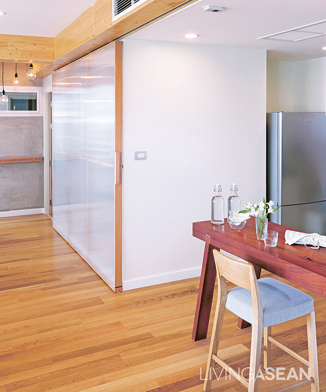 A sliding door partitions off the kitchen, and a counter divides usable space.
