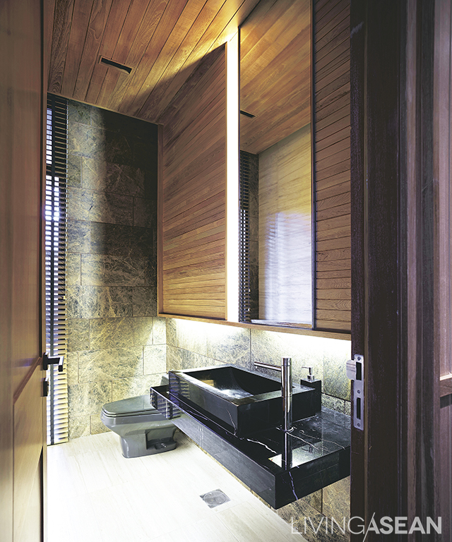 A bathroom décor of natural wood, which blends well with white and gray.
