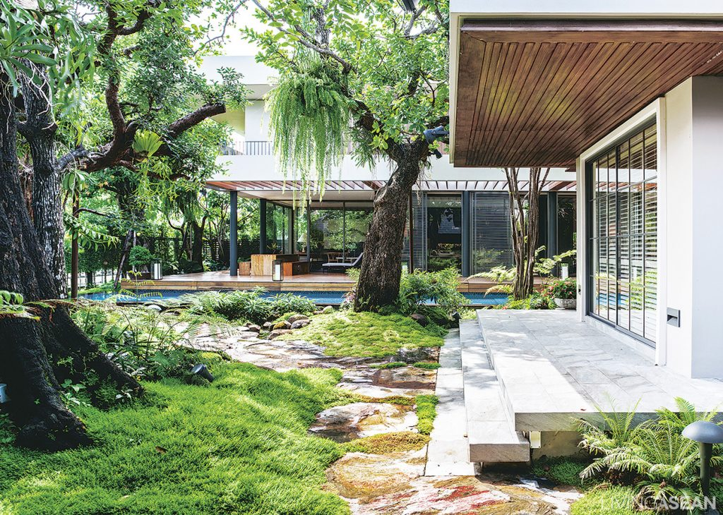 The overall harmony of garden and house architecture creates a relaxing atmosphere.