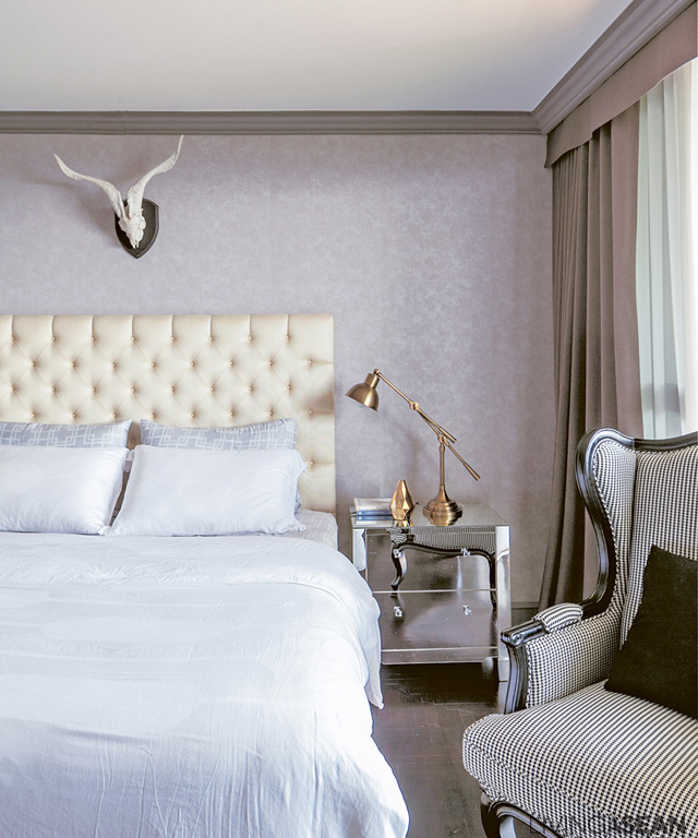 The upholstered head of the bed is taller than usual, easing the classic style a bit.