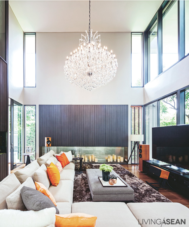 """Living room designed in """"open space"""" form, a 2-storey-high ceiling giving the feeling of openness and relaxation, all with a view of the garden."""