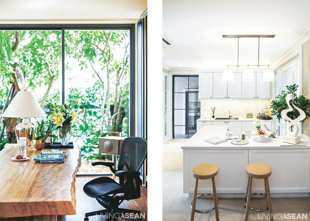 In the multipurpose room a big natural wood table is ready for all sorts of activities, from casual work to comfortable pleasure reading. /// The pantry is in white, both for increased light and a feeling of space and comfort.