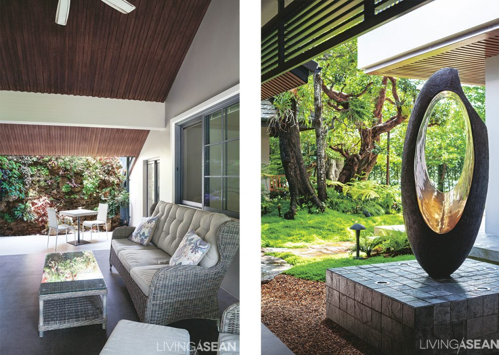 """Outdoor """"living room"""" for the family elders. /// A large sculpture adds dimension and narrative to the garden."""