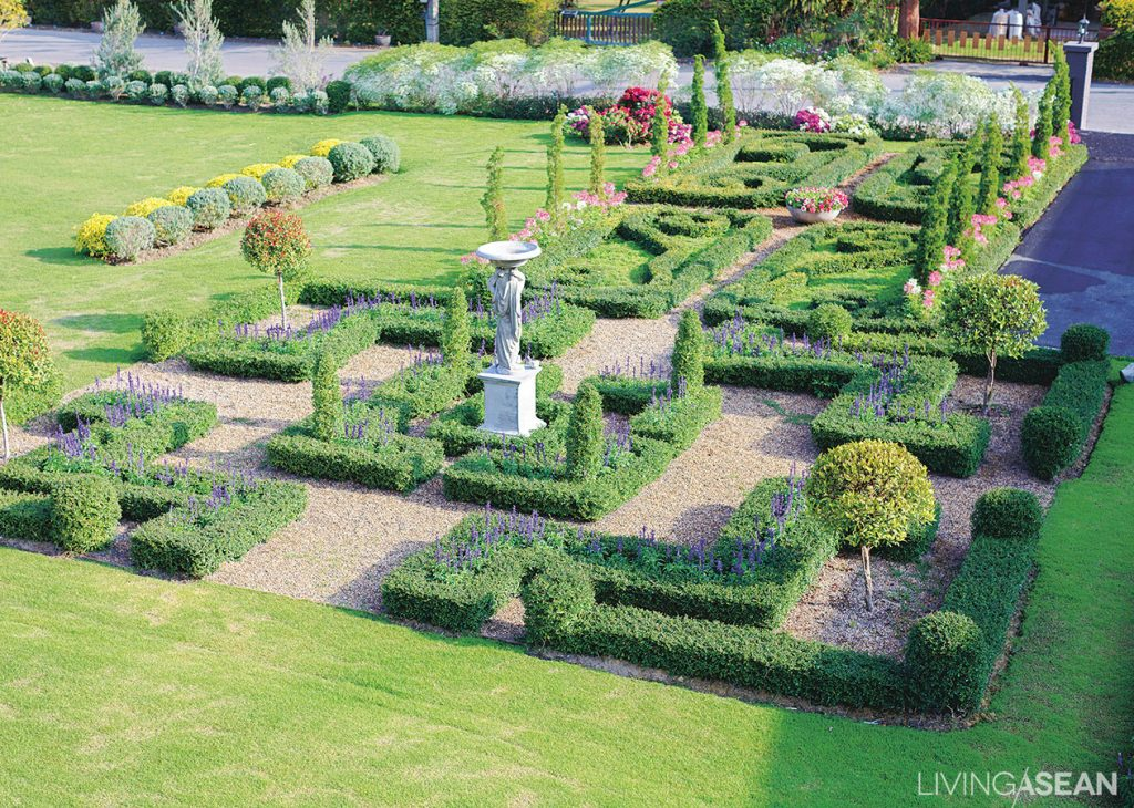 A Symmetrical Play Of Hedges And Plant Beds With Squared Or Rounded Frames  Are Interspersed With