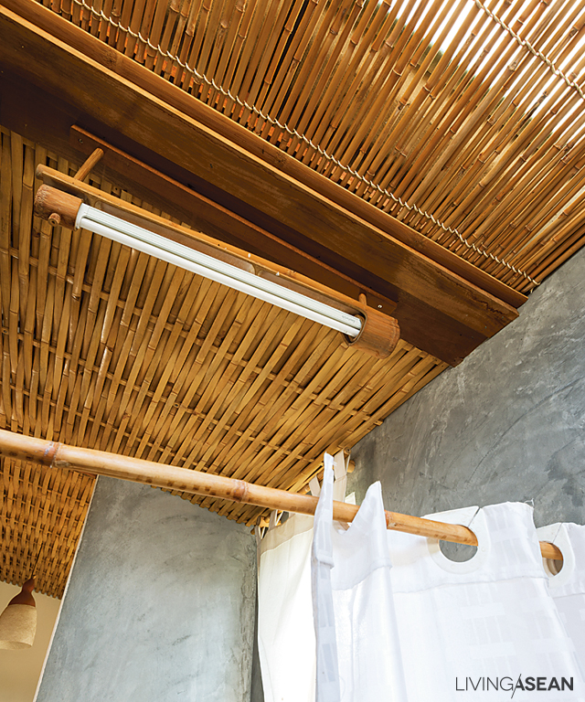 Ceiling treatments combine strand woven paneling with braid design, ideal bathroom décor of bamboo aficionados.