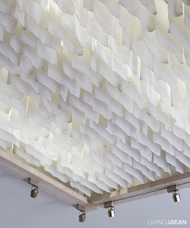 An ultramodern chandelier fashioned from sheets of mulberry paper fills the interior with an orchestra of electric lights.