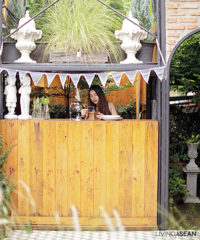 A cute outdoor kitchen is crafted of materials recycled from old scaffolding.