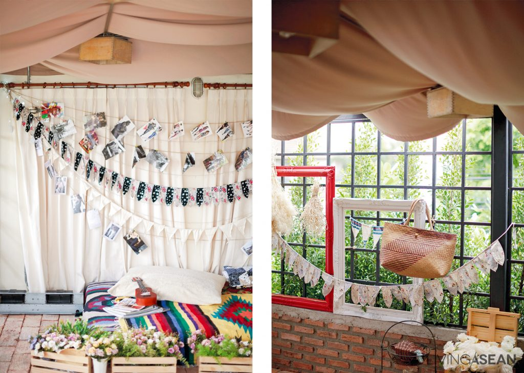 Intriguing window treatments and fabric drapery on the ceiling fill the room set for great photography amid a carnival ambience.