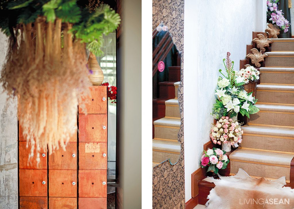 The eclectic style provides opportunities to find new meanings in vintage materials. Old boxes can transform into cool shelving, while ramie sacks make for good-looking carpet on the stairs.