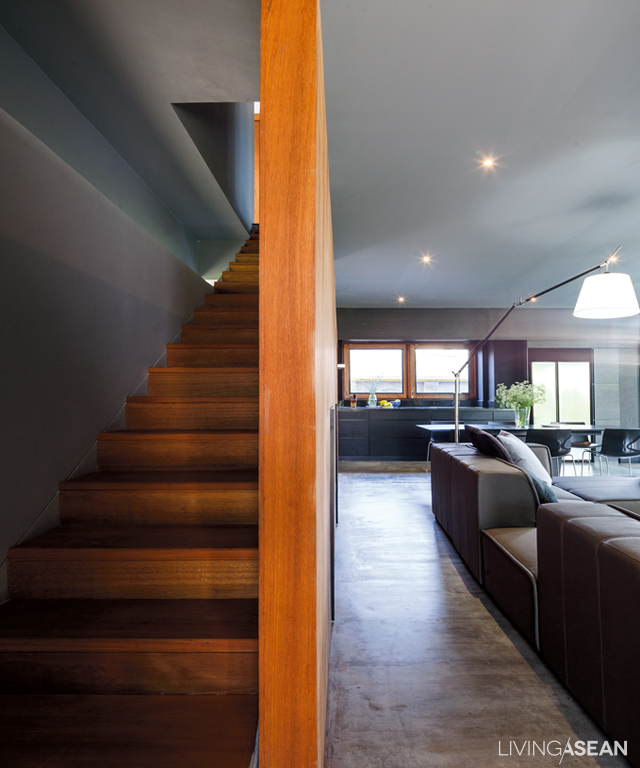 The staircase is neatly concealed. It's obvious the architect didn't want any line, shape, or form to interfere with the minimalist ambience.