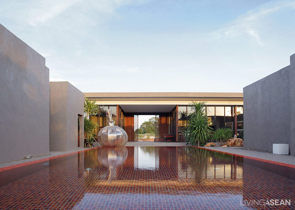 Beautiful abstract sculpture adds a modern appeal to the pool.