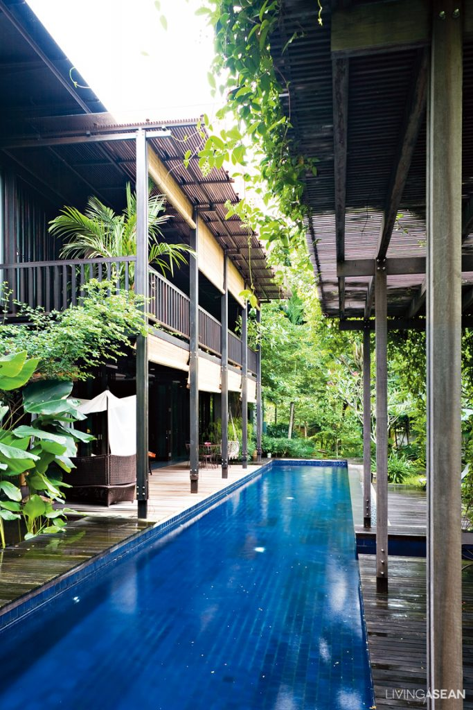nestled in a residential neighborhood near singapores downtown the house stands hidden in plain sight behind a row of leafy trees - Modern Tropical House Design
