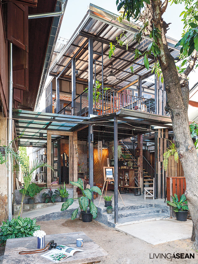 Loft-style home built out of much older Thai houses. /// Living ...