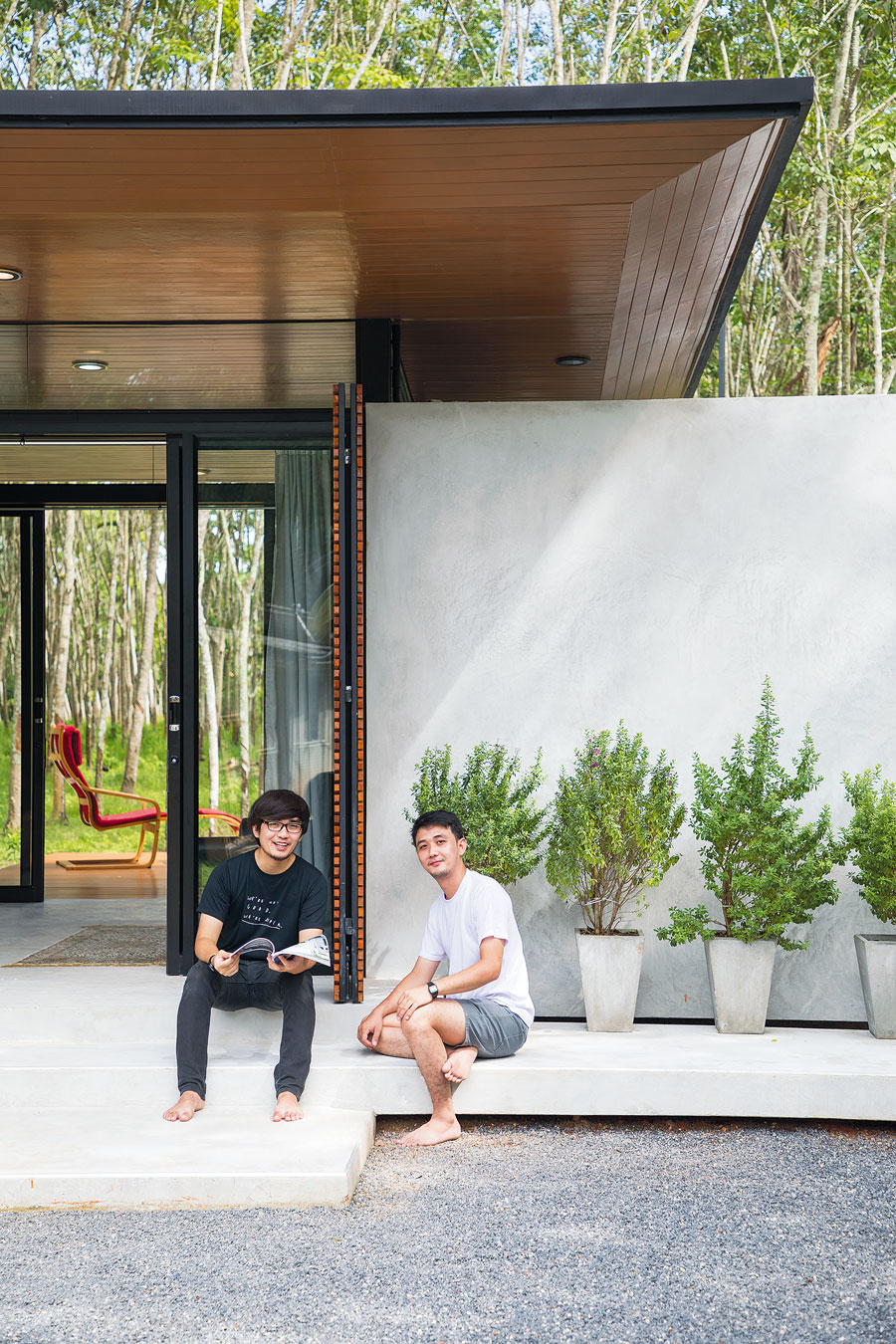 Compact House in a Rubber Forest