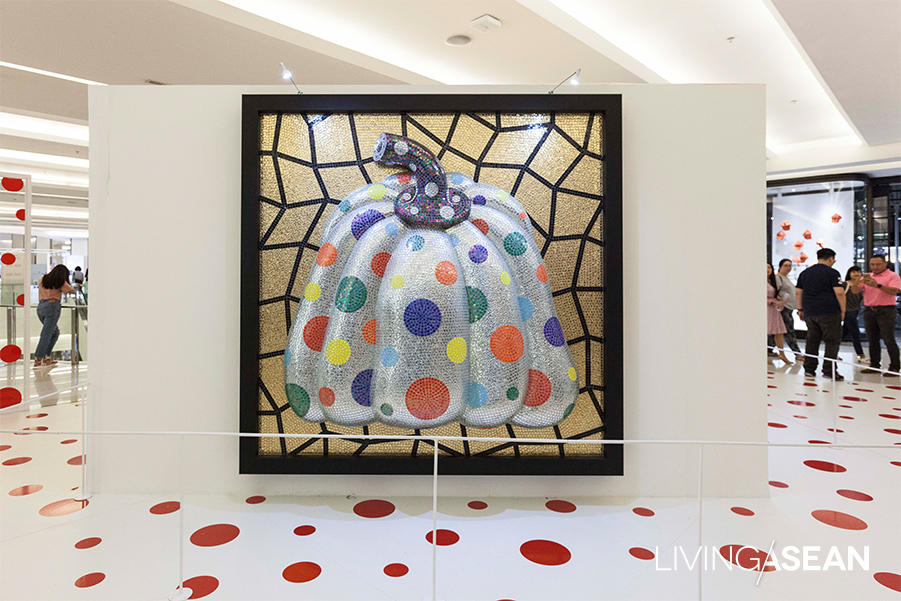 """Silver Pumpkin"" with a mosaic of multiple color dots, which is part of the ""I Carry on Living with the Pumpkins"" visual art collection, is on view at Siam Paragon (First floor, Fashion Gallery 3) 