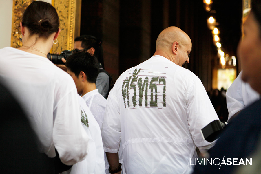 "Visitors put on Jitsing Somboon overcoats with the word ""Faith"" stenciled on their back as they enter the temple interior. I Photo courtesy of Singhanart Nakpongphun"