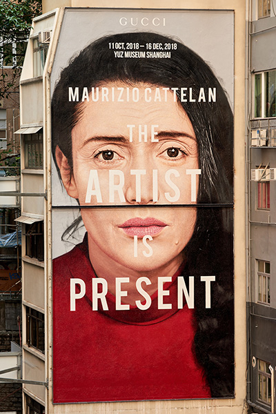 "In Hong Kong, a painting of Marina Abramovic for a Gucci art wall promoting ""The Artist Is Present"" event I Photo taken by Ronan Gallagher, inspired by the original taken by Marco Anelli I Courtesy of Gucci"