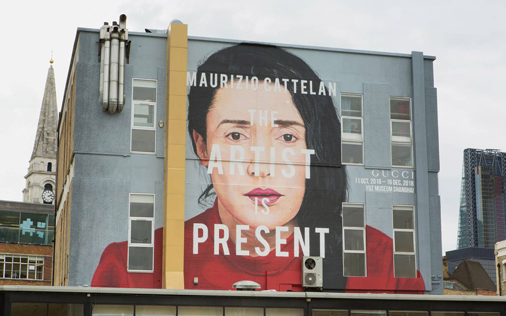 "In London, a painting of Marina Abramovic for a Gucci art wall promoting ""The Artist Is Present"" event I Photo taken by Ronan Gallagher, inspired by the original taken by Marco Anelli I Courtesy of Gucci"