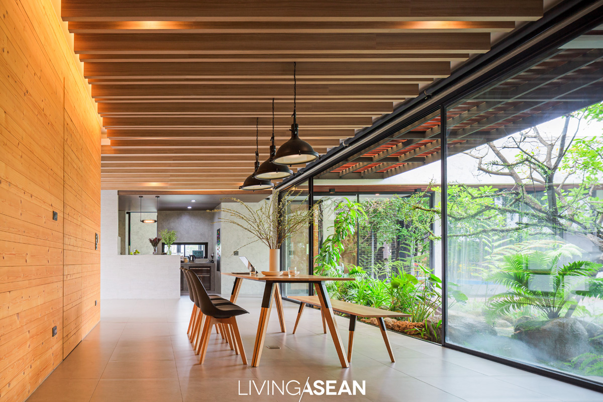 Multipurpose furniture is capable of adapting to many different functions, from dining room to sitting room with a view. The wooden panel wall to the left and hidden storage spaces are inspired by Apple store interior design.